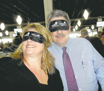 Toni and Jim Heady get ready for the blind taste test at the CNIB's  Dine in the Dark fundraiser.