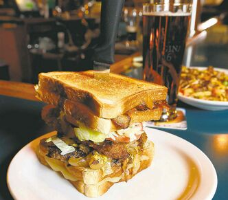 The Fox & Hounds' signature dish is the wolf hound burger, which is six ounces of ground beef wedged between two grilled cheese sandwiches.