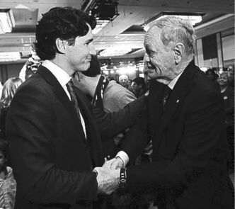 Justin Trudeau is congratulated by former prime minister Jean Chretien on his win for the Federal Liberal leadership in Ottawa on Sunday, April 14, 2013. THE CANADIAN PRESS/Sean Kilpatrick