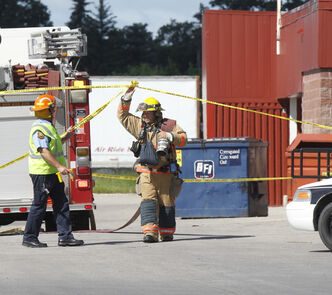 Winnipeg firefighters at the scene of a chemical spill at Grant Park High School this morning.