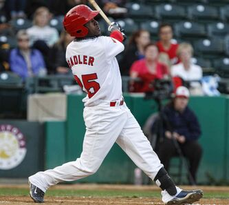 The Winnipeg Goldeyes' Ray Sadler watches the ball soar as the team faced off against the Sioux City Explorers at home on Wednesday, August 7, 2013. Sadler is one of seven players now signed for the Goldeyes' 2014 season.