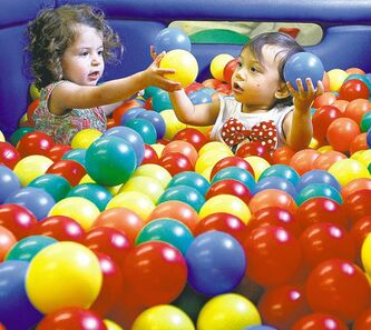 Brooke Babakhanians (left) plays in the ball pit with Mahailia Homes.