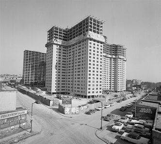 FILE - This Jan. 31, 1962 file photo shows apartment buildings under construction on the former site of Ebbets Field, former home of the Dodgers and Jackie Robinson, in the Brooklyn borough of New York. With the new movie