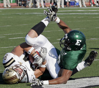 Western Michigan tight end Matt Stevens, left, catches a one-yard touchdown pass against Eastern Michigan linebacker Andy Mulumba during the first quarter of a NCAA college football game in 2009.