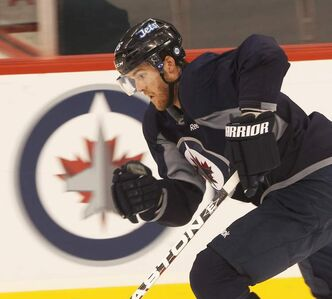 Mark Flood skates at a Jets practice at the MTS Centre in December. He saw little game time as a Jet.