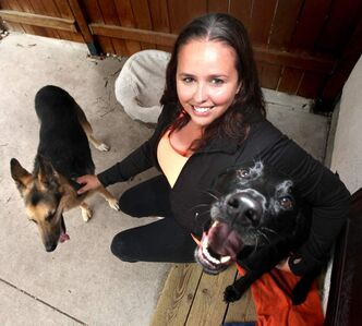 Paw Tipsters' Yvonne Russell at home with her pooches Mike (left) and Garry.
