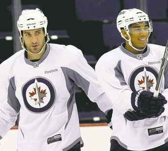 Chris Thorburn and Evander Kane. The Winnipeg Jets practice at Nationwide Arena in Columbus, Ohio. Sept. 20, 2011 (BORIS MINKEVICH / WINNIPEG FREE PRESS)