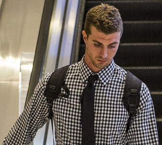QB Justin Goltz arrives at the Winnipeg James Armstrong Richardson International Airport Sunday morning.