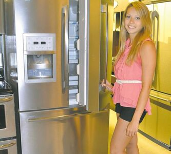 Laura Ripley of Kern-Hill Furniture shows a French-door Frigidaire Pro Series stainless-steel refrigerator priced from about $1,900 to $2,200.