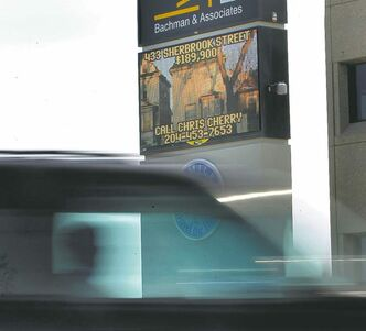 A motorist passes an electronic sign on McMillan Avenue.