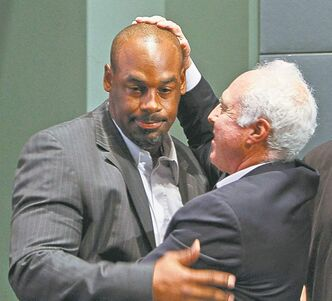 Donovan McNabb and Philadelphia Eagles owner Jeffrey Lurie embrace on Monday before McNabb's official retirement.