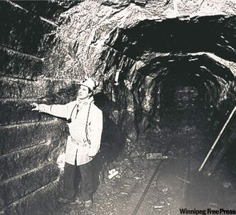 Supervisor tours tunnel in 1986.