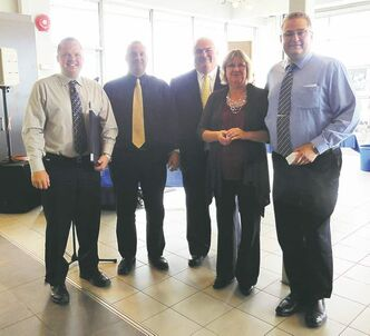 Salesmen Gold Guild winners, from left: John Puchniak, Mike Richardson, Jim Chewka (general manager), Heather Spencer (district manager for General Motors) and Craig Pucely.