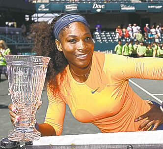 Serena Williams displays her third Family Circle Cup trophy Sunday.