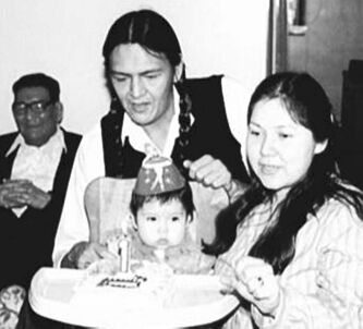 Eric Robinson and his wife, Catherine, with their daughter, Shaneen, in this undated photo. Robinson's father is seen at left.