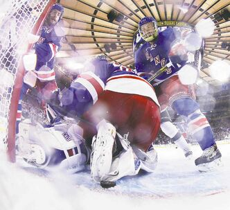 New York Rangers goalie Henrik Lundqvist looks for one of two pucks that barely missed counting for the Kings Wednesday night.