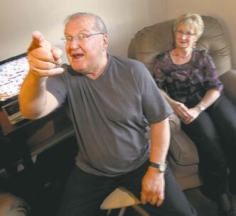 Dave Labelle gestures and jokes with his wife, Carol.