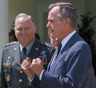 "FILE - In this April 23, 1991 file photo, Gen. Norman Schwarzkopf, left, looks on as President George Bush speaks to reporters in the White House Rose Garden as in Washington. Bush praised the general for leading a ""fantastic"" effort to fulfill U.S. obligations in the gulf, and for helping to build ""unbelievable"" morale on the home front. Schwarzkopf died Thursday, Dec. 27, 2012 in Tampa, Fla. He was 78. (AP Photo/Barry Thumma, File)"