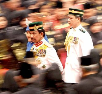 Brunei's Sultan Hassanal Bolkiah, left, attends a celebration held in Bandar Seri Begawan, Brunei.