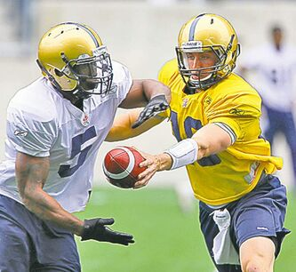 Chad Simpson (left) and Justin Goltz at camp Sunday.