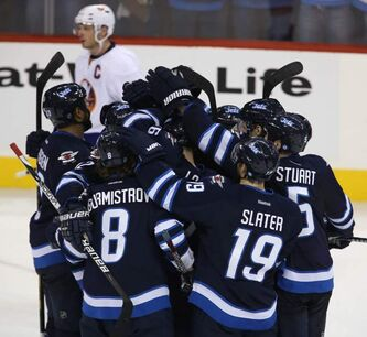 The Winnipeg Jets' mob Evander Kane (9) after he scored the game-winning overtime goal against the New York Islanders on Sunday.