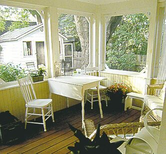 A screened porch is always a cozy and cool gathering spot.