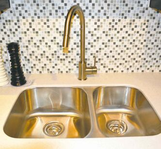 Stainless-steel sink (about $550) and faucet (about $230) from IKEA.