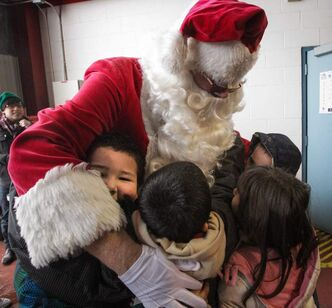 Santa is swarmed as he arrives after his flight.