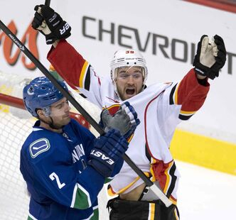 T.J. Galiardi, right, scroed four goals and earned 17 points in 62 games with Calgary last year.