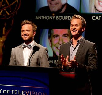Actors Aaron Paul, left, and Neil Patrick Harris announce nominations at the 65th Primetime Emmy Announcements.