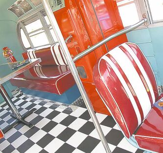 Randy and Sandy Klym displayed their old-school 1957 GMC bus. Check out the 1950s diner-inspired interior.