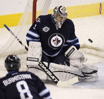 Winnipeg Jets' goaltender Ondrej Pavelec (31) eyes the puck as the Jets face the Edmonton Oilers during second-period NHL hockey action in Winnipeg on Monday.