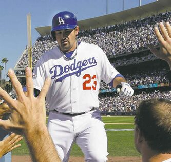 Los Angeles Dodgers' Adrian Gonzalez is congratulated after hitting a home run Wednesday.