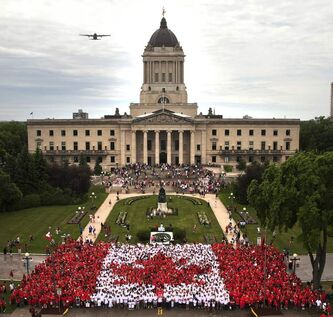 Thousands of Winnipeggers wearing red and white t-shirts gathered at the legislative grounds July, 1, 2011 to form a human flag as part of Canada Day celebrations.