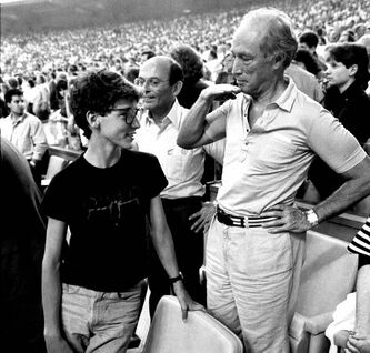 Former prime minister Pierre Trudeau takes the measure of his son Justin (top) at a Montreal Expos game in 1987.