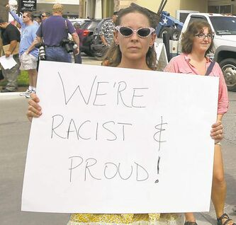 Renee Vaughan holds a sign at a pro-stand-your-ground rally in Houston, Texas Sunday.