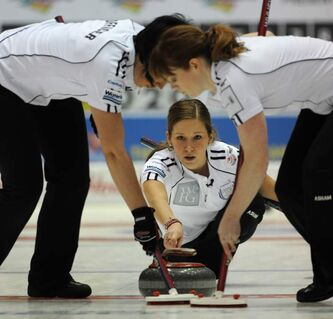 Skip Kaitlyn Lawes deliver her stone as her front end of lead Dawn Askin,second Jill Officer brush her stone during her semi-final win over Heather Nedhoin 9-5 to advance to the finals at the Capital One Canada Cup Curling action in Moose Jaw, Sask., on Saturday.