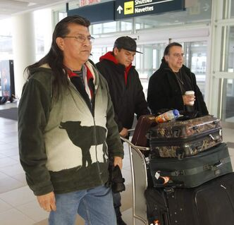 From left, Cross Lake First Nation elder Raymond Robinson and son Baptiste, 21, and Chief Garrison Settee at the James A. Richardson International Airport to catch a flight to Ottawa Monday. Robinson is joining Chief Spence of Attawapiskat in her hunger strike. Robinson has been on a hunger strike since Dec 12.