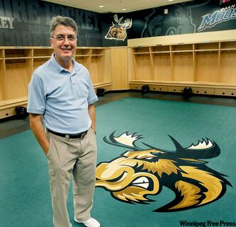 New Manitoba Moose head coach Claude Noel has a tough job ahead -- pleasing the bosses of two teams.