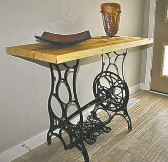 An antique sewing machine crafted into a side table.