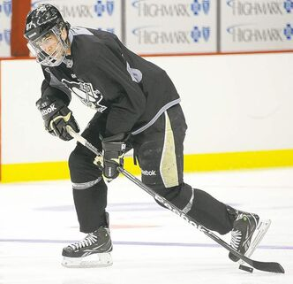Penguins captain Sidney Crosby, sporting a protective mask, skates at the Consol Energy Center in Pittsburgh Monday, the first time since suffering a broken jaw.