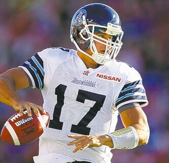 Toronto Argonauts' quarterback Zach Collaros, looks for a receiver during first quarter CFL football action against the Calgary Stampeders in Calgary, Alta., Saturday, Sept. 21, 2013. THE CANADIAN PRESS/Jeff McIntosh
