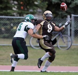 Saskatchewan Huskies Luke Thiel and Manitoba Bisons Nic Demski fight for the ball Saturday at the University of Manitoba.
