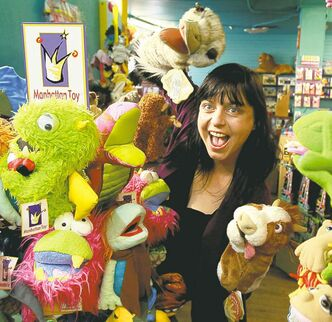 Twyla Motkaluk plays around in her West  Kildonan toy store.