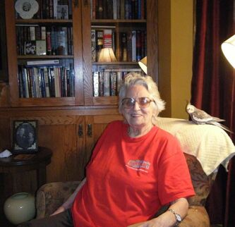 <p>Supplied photos</p><p>Quick-witted Lorna Christianson, seen here with her pet bird, cared about helping others and moved through the world without judgment. Christianson died in October at the age of 88.</p>