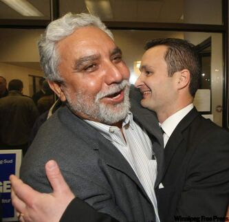 Incumbent MP Rod Brunooge, right, celebrates with a good friend Amarjeet Warraich.