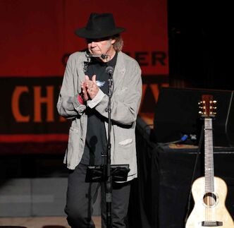 Neil Young performs at the Centennial Concert Hall Thursday night.
