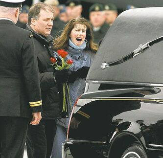 Peter Redman / The Canadian Press ArchivesJanet Baker, mother of Cpl. Josh Baker, grieves beside the hearse carrying her son�s remains at CFB Trenton, Ont., on Feb. 15, 2010.
