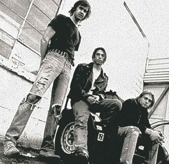 FILE - This 1991 file photo shows the band Nirvana, from left, Krist Novoselic, Dave Grohl, and Kurt Cobain. Nirvana will be inducted into the 2014 Rock and Roll Hall of Fame on April 10, 2014, at the Barclays Center in New York. (AP Photo/Chris Cuffaro, File)
