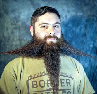 Who could blame a man for wanting a little 'enhancement' when the result could be a luxuriant beard like the one sported by Drew Running of the Minneapolis Beard and Moustache Club?